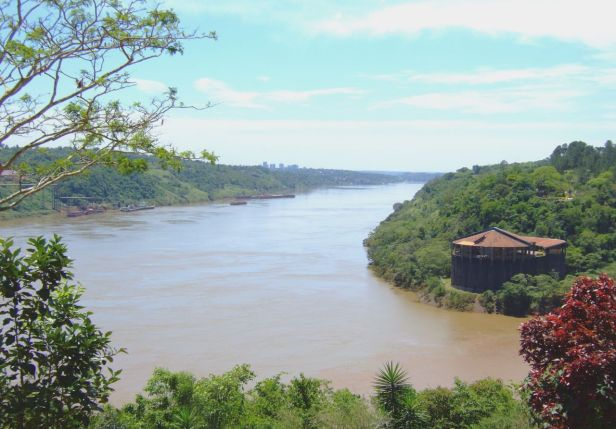 View from Argentina towards Brazil (top right) and Paraguay (top left) at the confluence of the Iguaçu and Paraná rivers.